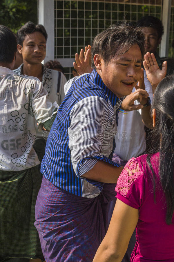 In dance. The people dancing in time of playing music on a traditional music instrument during the holidays religious in a small village in Myanmar Burma stock photography
