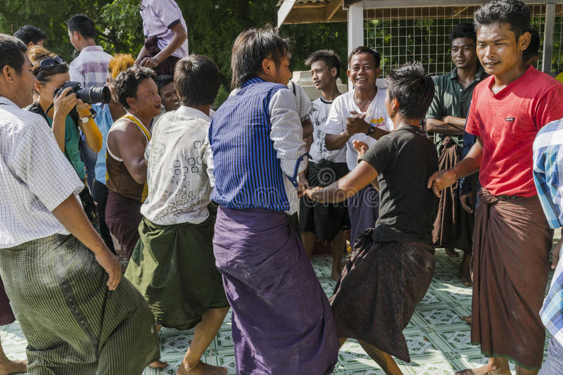 In dance. The people dancing in time of playing music on a traditional music instrument during the holidays religious in a small village in Myanmar Burma royalty free stock photos