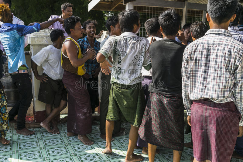 In dance. The people dancing in time of playing music on a traditional music instrument during the holidays religious in a small village in Myanmar Burma royalty free stock photo