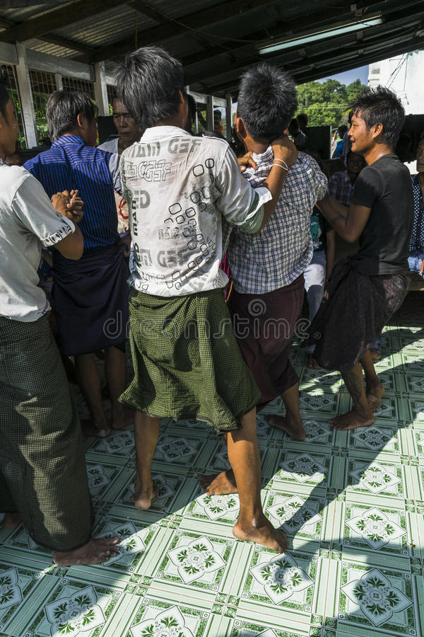 In dance. The people dancing in time of playing music on a traditional music instrument during the holidays religious in a small village in Myanmar Burma stock photo