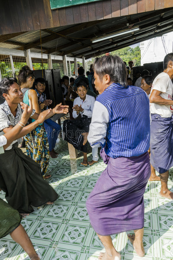 In dance. The people dancing in time of playing music on a traditional music instrument during the holidays religious in a small village in Myanmar Burma royalty free stock photography