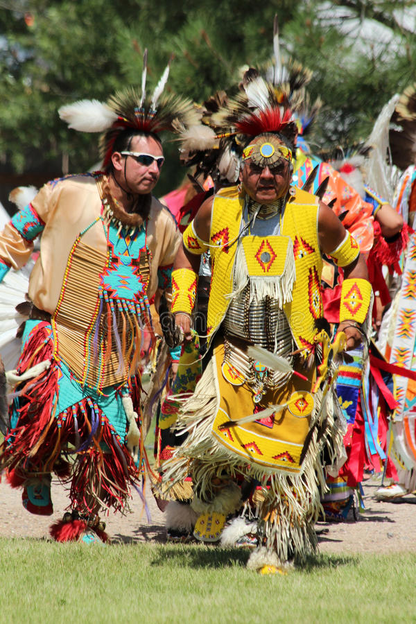 Dance - Powwow 2013. Two Native American dancers perform a dance in the Indian Village at Cheyenne Frontier Days 2013 stock photography