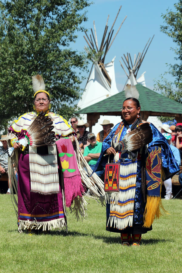 Dance - Powwow 2013. Two Native American dancers perform a dance in the Indian Village at Cheyenne Frontier Days 2013 royalty free stock photo