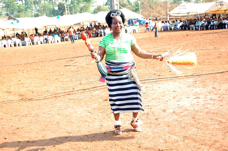 DANCE AND SPIRITUALITY. An African dancer in sketch dance steps of funeral ceremony in occultism to spread the wrong spell during the ceremony by removing bad stock images