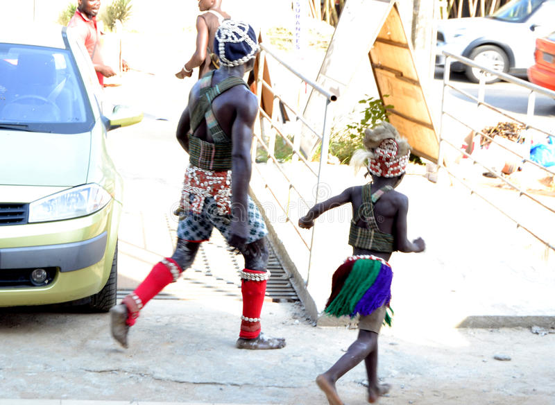 DANCE AND SPIRITUALITY. An African dance group presenting in various ways dancing in occultism to ward off bad spells in the village by removing bad vibrations stock images