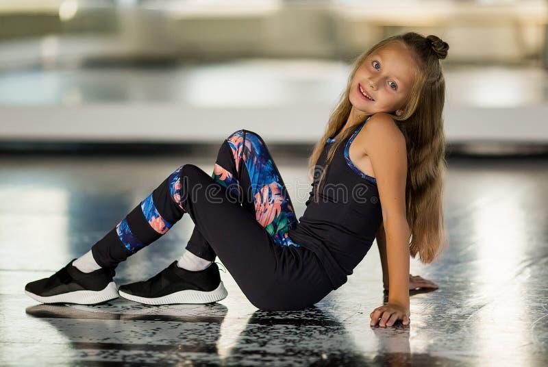 Dance styles street dancers, hip hop. Flexible body. Girl in a dance studio in a suit. Dance styles street dancers, hip hop. Flexible body. Girl in dance studio royalty free stock photography