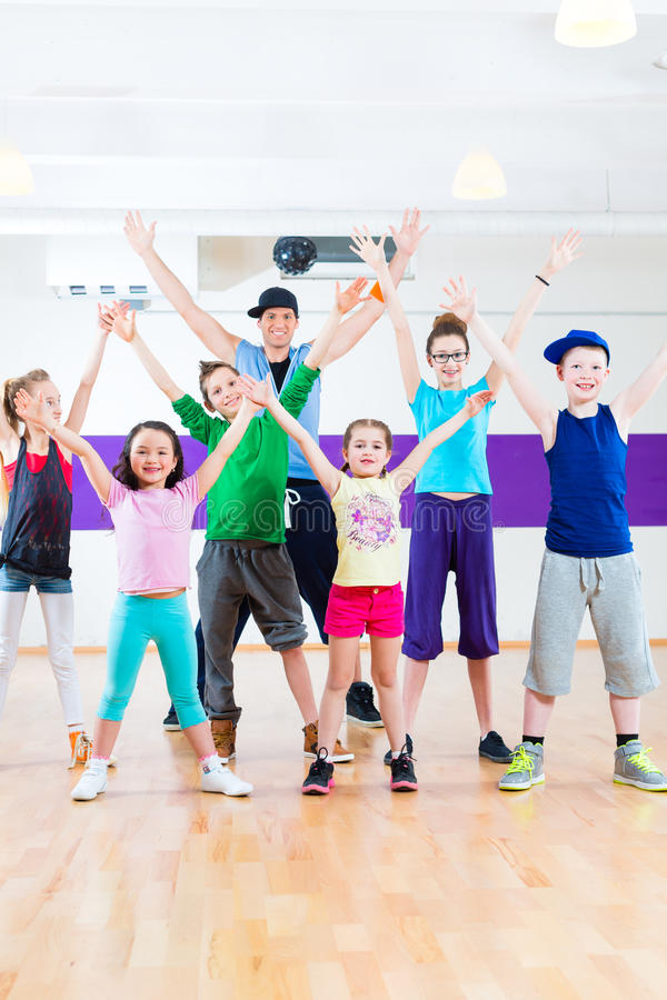 Dance teacher giving kids Zumba fitness class royalty free stock images