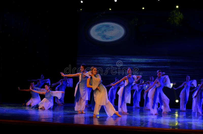 The search of the sea 1 -Chinese folk dance. Dance is the transformation of the sea, like a girl, like a shrew, but a mother`s mind. In June 13, 2018, dance royalty free stock photo