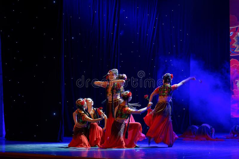 Send you a rose 1 -Chinese national dance in Xinjiang. It is a dance widely distributed in the Uygur ethnic group, accompanied by the music of the king of the royalty free stock image