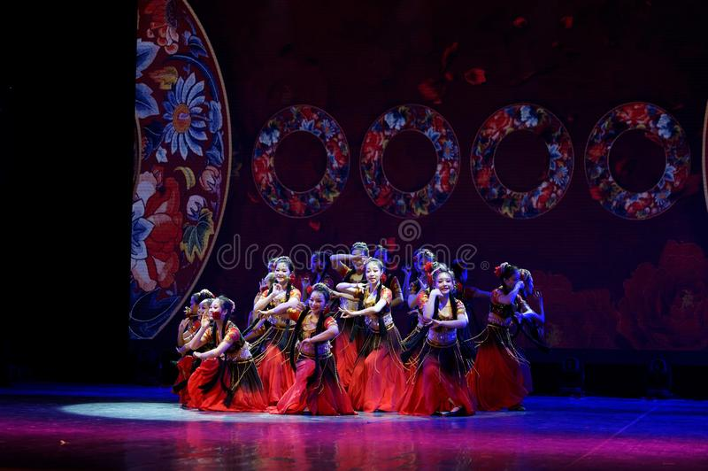 Send you a rose 4 -Chinese national dance in Xinjiang. It is a dance widely distributed in the Uygur ethnic group, accompanied by the music of the king of the stock photos