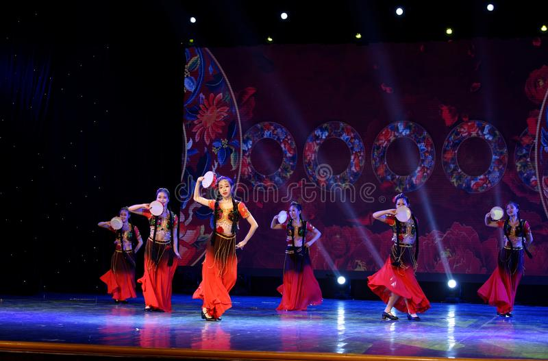 Send you a rose 4 -Chinese national dance in Xinjiang. It is a dance widely distributed in the Uygur ethnic group, accompanied by the music of the king of the stock photo