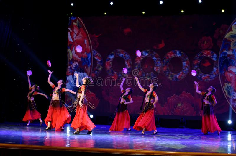Send you a rose 1 -Chinese national dance in Xinjiang. It is a dance widely distributed in the Uygur ethnic group, accompanied by the music of the king of the stock image