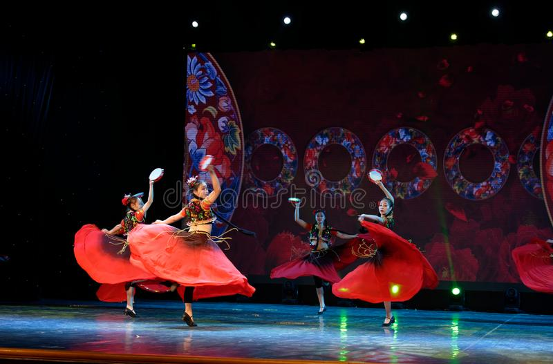 Send you a rose 2 -Chinese national dance in Xinjiang. It is a dance widely distributed in the Uygur ethnic group, accompanied by the music of the king of the royalty free stock photo