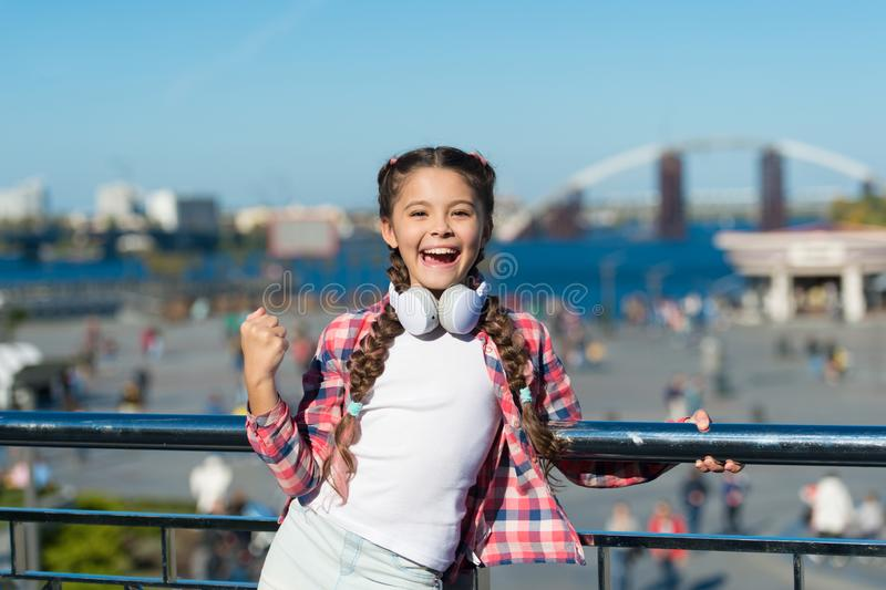 Dance for your happiness. Little music fan. Little girl listen to music outdoor. Happy little girl. Happy child wear royalty free stock photos