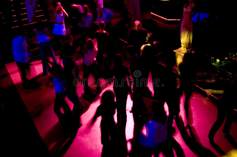Dancefloor Frenzy. Motion blur shot of the silhouettes on a nightclub's dancefloor, a bit dark, but that's how it is in nightclubs