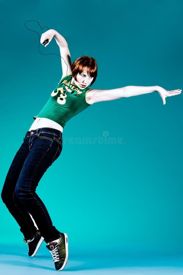 Dancepose com o jogador mp3 fotos de stock