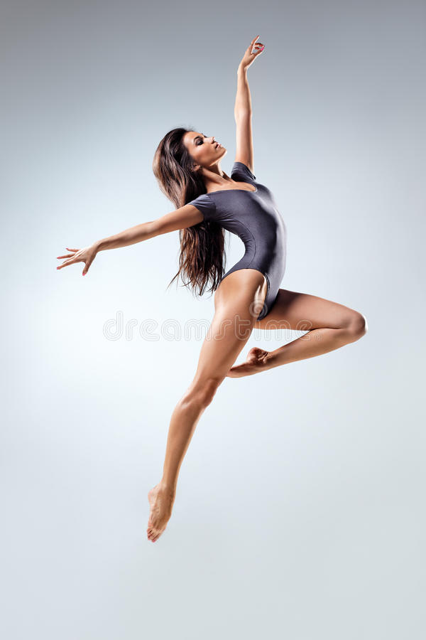 The dancer. Young and beautiful dancer posing in studio royalty free stock images