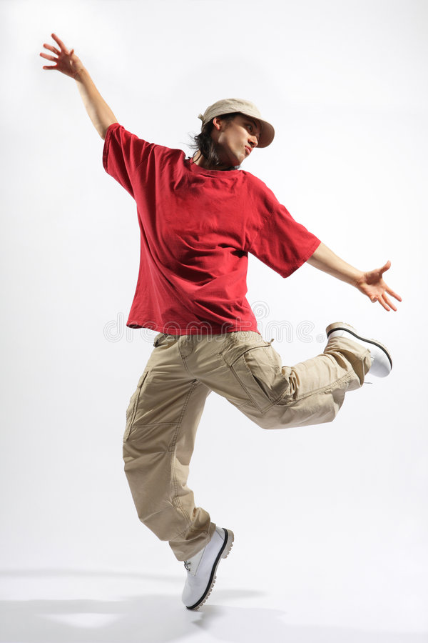 The dancer. Hip-hop style dancer posing on isolated background royalty free stock image