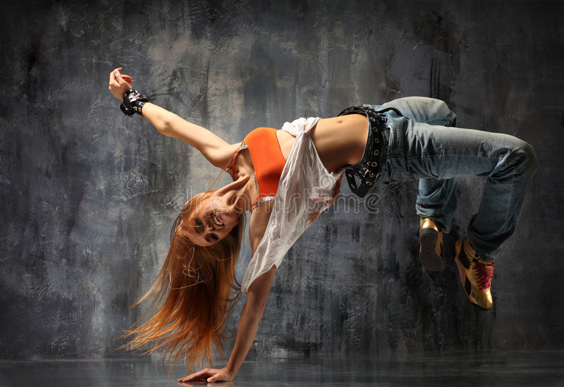 The dancer. Modern style dancer posing behind studio background royalty free stock photos
