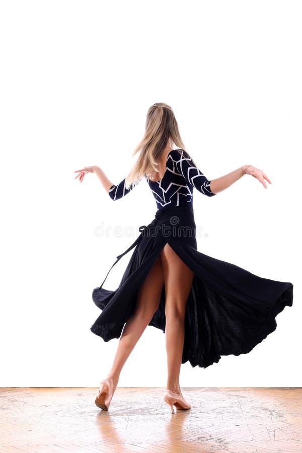 Dancer in ballroom against white background stock image