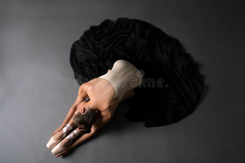 Dancer in beige underwear and pointe high angle view stock images