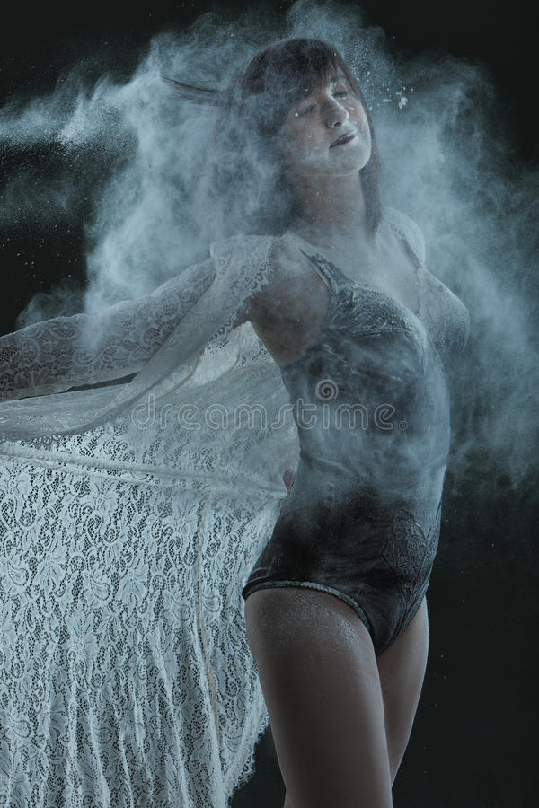 Dancer in a cloud of dust. royalty free stock photography