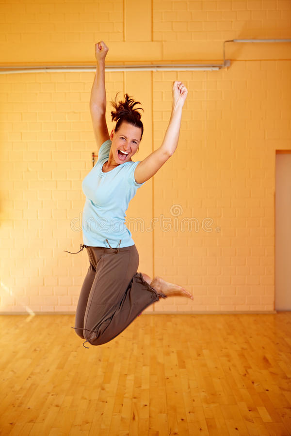 Dancer cutting a caper. Happy female dancer jumping into the air royalty free stock image