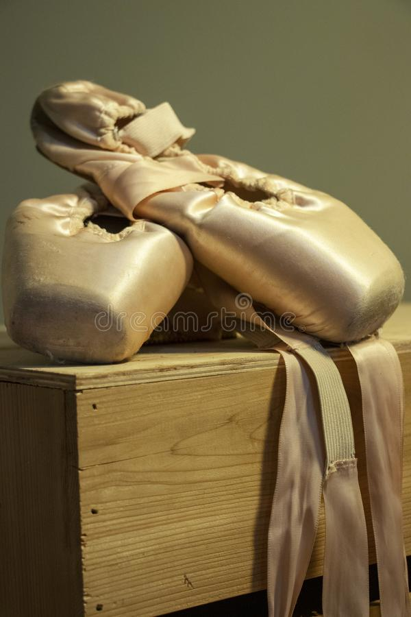 Point shoes on a wood box royalty free stock photo
