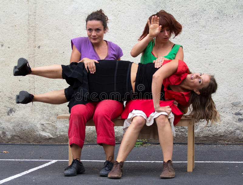 Download Dancer On The Knees Of Two Women Editorial Image - Image of demonstration, image: 26624555