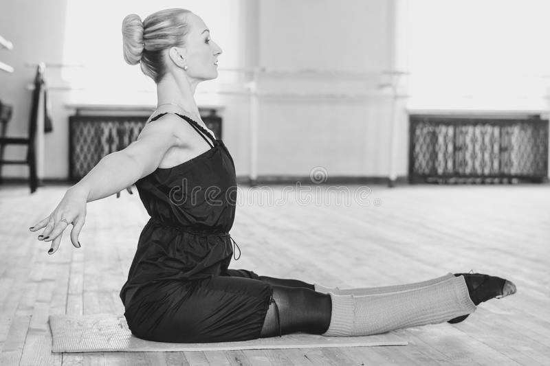 The dancer makes the warm-up. In the ballet hall stock photos