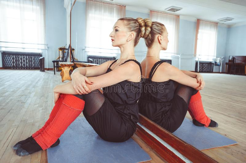 The dancer makes the warm-up. In the ballet hall stock images