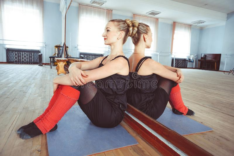 The dancer makes the warm-up. In the ballet hall royalty free stock photography