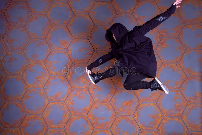 Dancer in motion. Young dancer jumping high. Urban style royalty free stock image