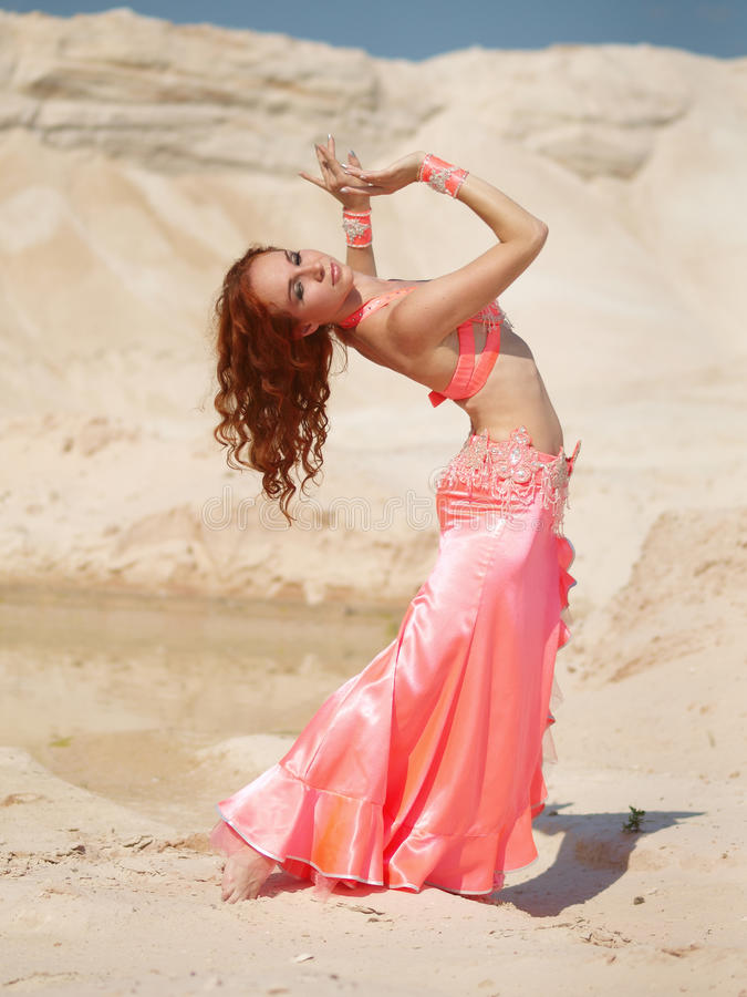 Dancer in ping dress royalty free stock photography