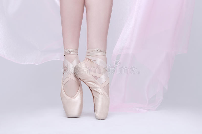 Dancer In Pink Pointe Shoes Using Proper Technique. Ballet Dancer In Pink Pointe Shoes Using Proper Technique royalty free stock image