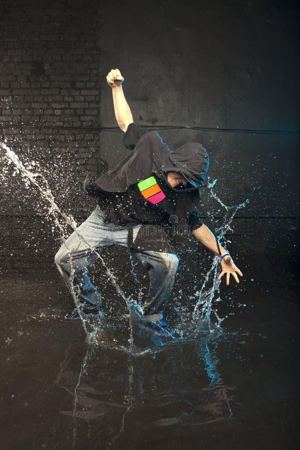 Dancer in rain stock photos