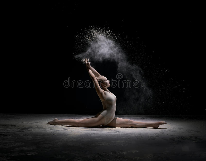 Dancer sitting on stage in cloud of powder royalty free stock photo