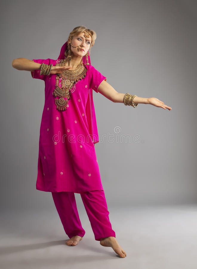 Dancer stand in rose oriental indian costume royalty free stock photography