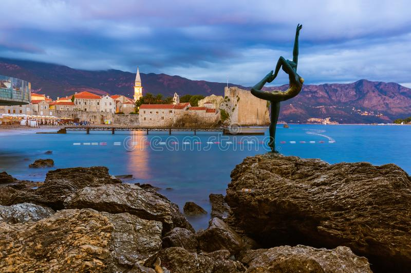 Dancer statue and Old Town in Budva Montenegro royalty free stock images