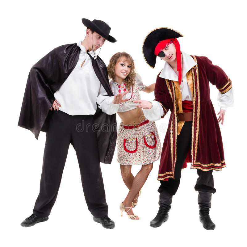 Dancer team wearing Halloween carnival costumes dancing against white in full body royalty free stock images