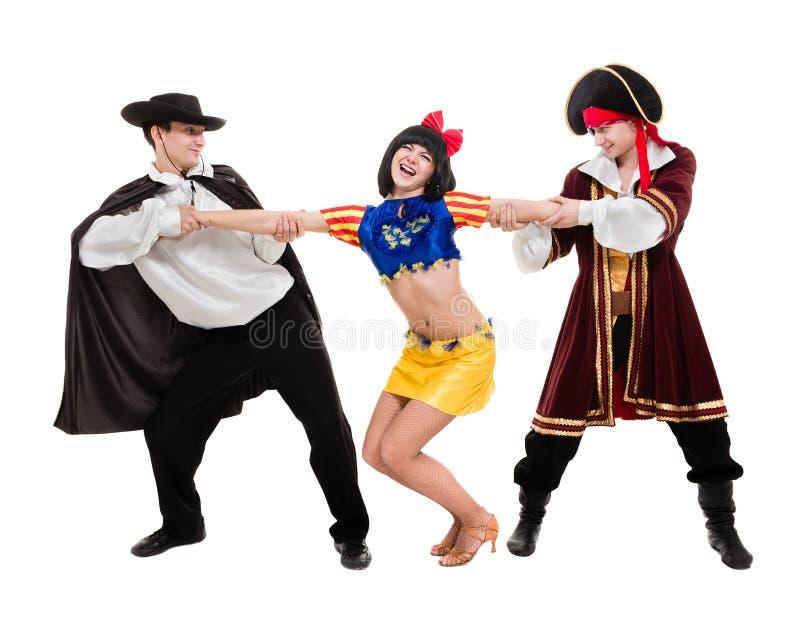 Dancer team wearing Halloween carnival costumes dancing against white in full body stock image