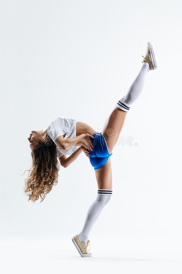 The dancer. Young beautiful dancer jumping on a studio background royalty free stock image