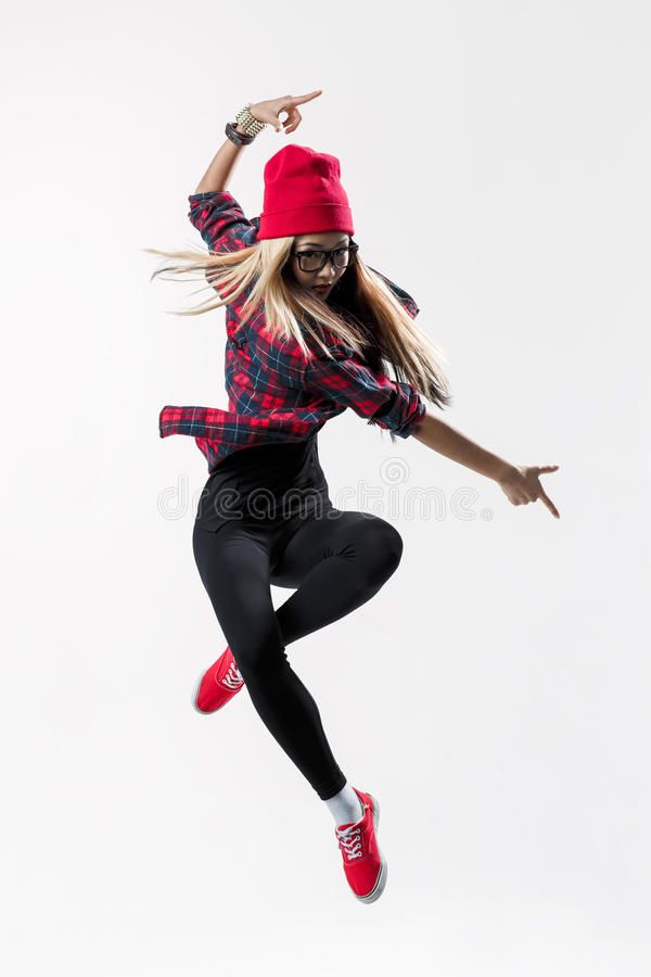 The dancer. Young beautiful dancer jumping on a studio background stock image
