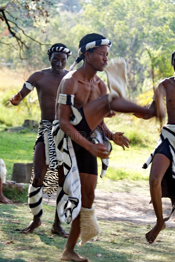 Dancers at a boat launch. African dancers by a boat launch on the Zambezi River in Victoria Falls, Zimbabwe stock photos