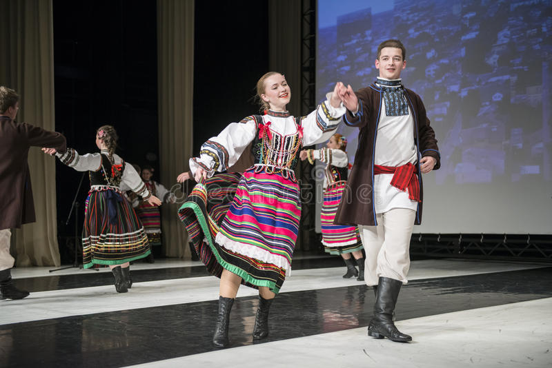 Dancers of Chodowiacy Dance Group perform on stage. SIEDLCE, POLAND 6 APRIL: dancers of Chodowiacy Dance Group perform on stage at CKiS theatre on April 6 2013 royalty free stock photo