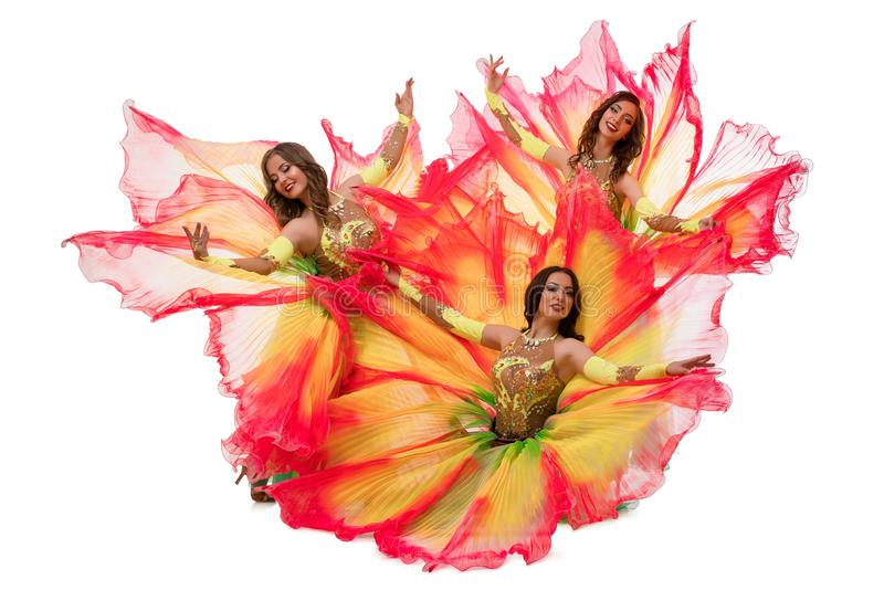 Dancers in colorful artistic dresses shot. Dancers in colorful artistic dresses isolated high angle shot stock photography