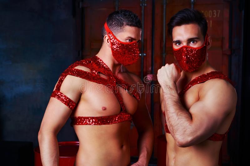 Dancers dressed in red costumes stock images