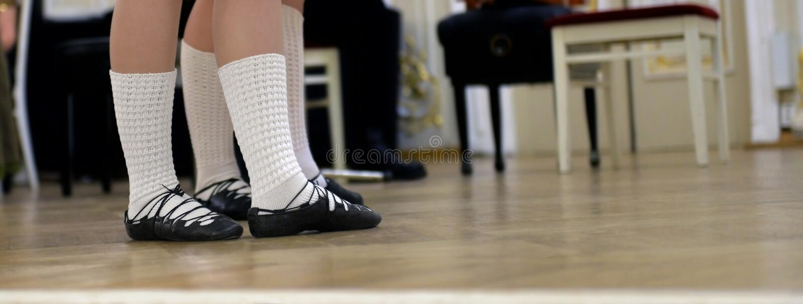 Dancers feet shod in shoes for Celtic dance. Dancers feet shod in soft shoes for Celtic dancing on stage royalty free stock images