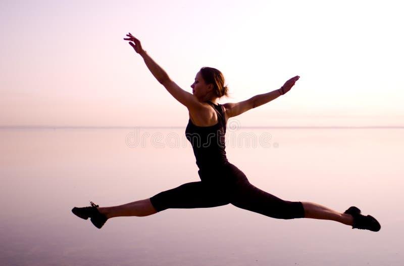 Dancers jump split stock images