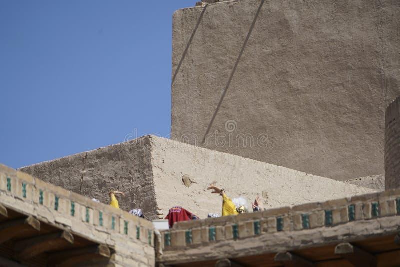 Dancers on the Khiva city walls stock photo